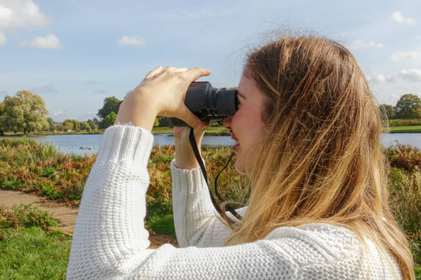 picturesque landscape surveyed by beautiful blonde bulgraian outdoor girl - whiteway bulgarian outdoor girl stock photos and pictures
