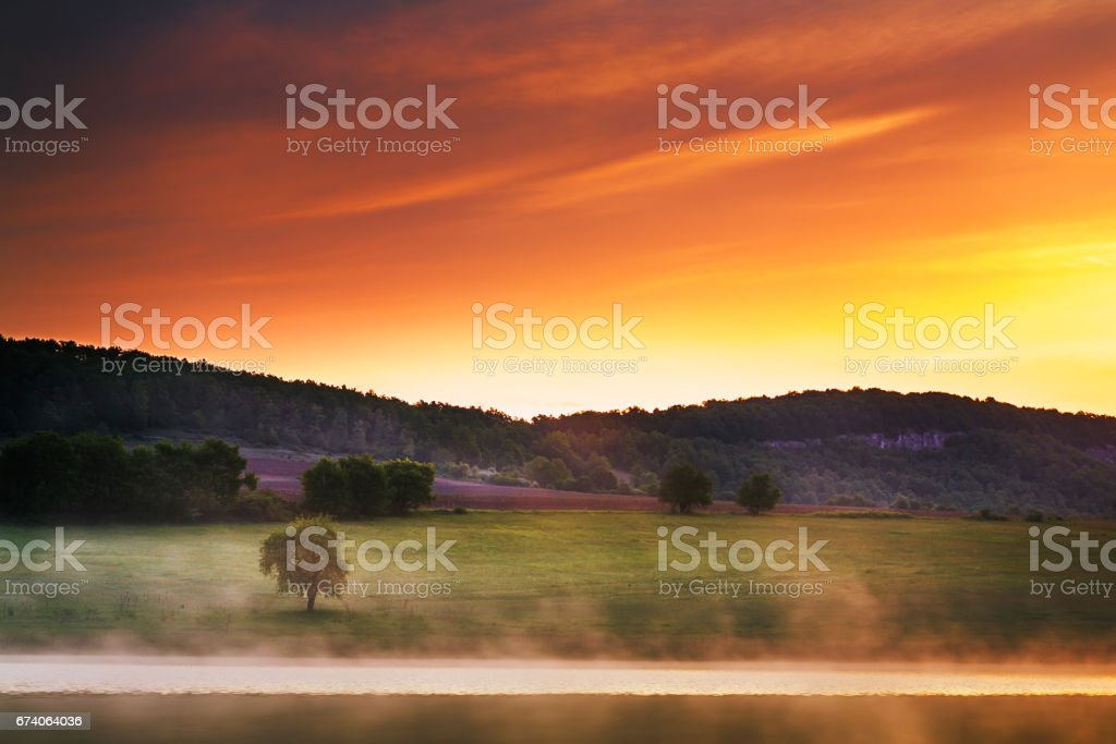 Picturesque lanscape by the lake at sunrise royalty-free stock photo