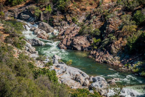 Picturesque mountain river in the Kings Canyon Preserve, California. Clear water of a mountain river stock photo