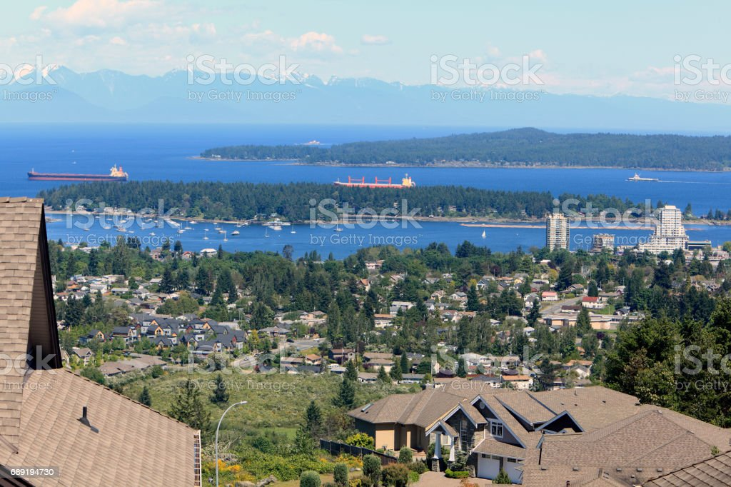 Picturesque Nanaimo Harbor Below Modern Homes And Roof Tops stock photo
