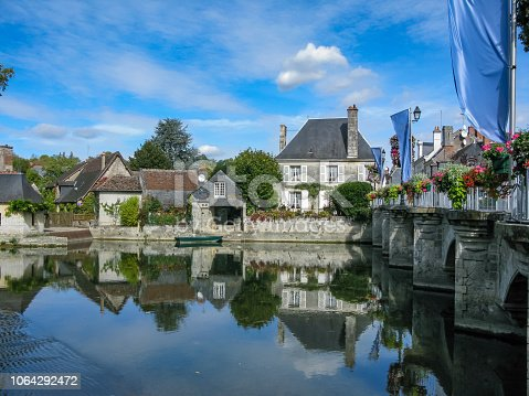 istock picturesque old houses on the canal in the Loire, France 1064292472