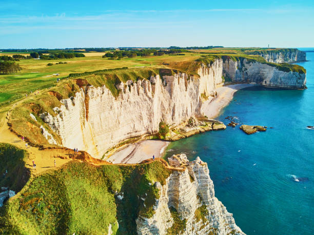 picturesque panoramic landscape of white chalk cliffs and natural arches of etretat, normandy, france - english channel stock pictures, royalty-free photos & images
