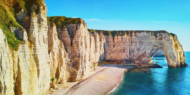 Picturesque panoramic landscape of white chalk cliffs and natural arches of Etretat, Normandy, France stock photo