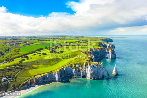Picturesque panoramic landscape on the cliffs of Etretat. Natural amazing cliffs. Etretat, Normandy, France, La Manche or English Channel. France