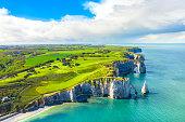 Picturesque panoramic landscape on the cliffs of Etretat. Natural amazing cliffs. Etretat, Normandy, France, La Manche or English Channel. France
