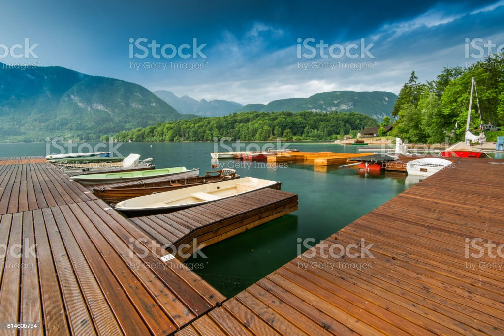 Picturesque pier with boats at Bohinj Lake,Slovenia stock photo