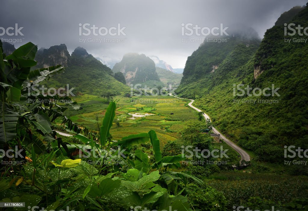Picturesque road among the karst mountains leads to the town of Cao Bang which is located in the North of Vietnam. stock photo