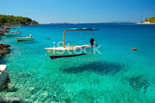 istock Picturesque scene of boats on Adriatic bay -Brac island, Croatia 178702550
