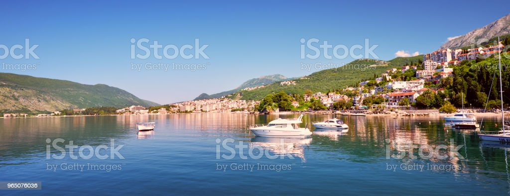 Picturesque sea view of Boka Kotorska, Montenegro, Herzeg Novi old town fortress. Shoot wide angle, sunset royalty-free stock photo