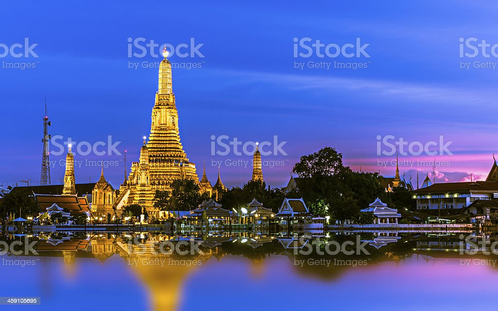 Picturesque skyline of Wat Arun with lit-up buildings stock photo