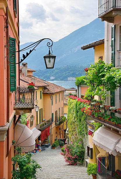 picturesque small town street view in lake como italy - como italië stockfoto's en -beelden