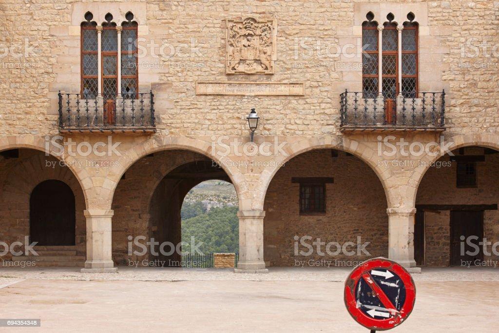 Picturesque stoned arcaded square in Spain. Cantavieja, Teruel. stock photo