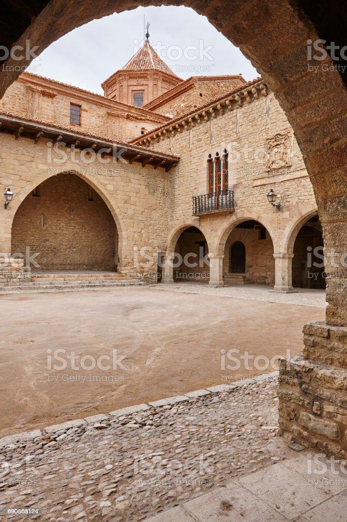 Picturesque stoned arcaded square in Spain. Cantavieja, Teruel. Spanish stock photo