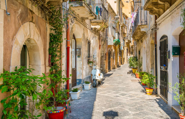 Picturesque street in Ortigia, Siracusa old town, Sicily, southern Italy. Picturesque street in Ortigia, Siracusa old town, Sicily, southern Italy. sicily stock pictures, royalty-free photos & images