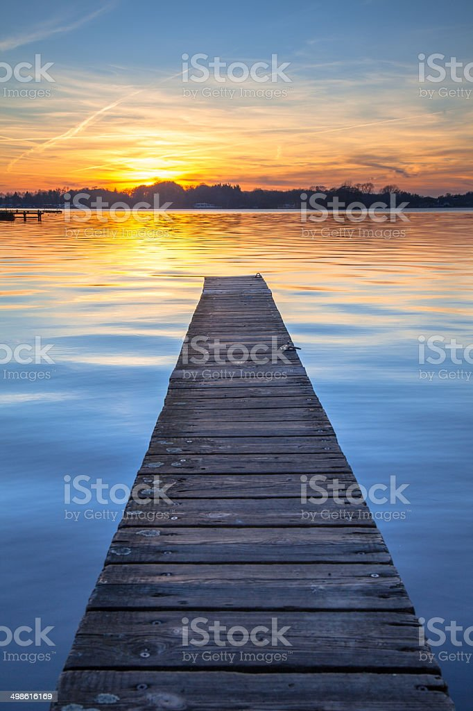 Picturesque Sunset over Wooden Jetty in Groningen, Netherlands stock photo