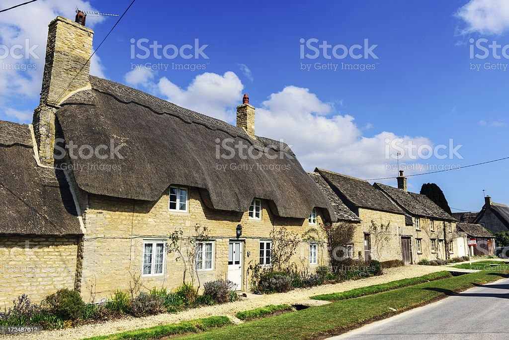 Picturesque thatched Cotswold Cottage in Minster Lovell stock photo