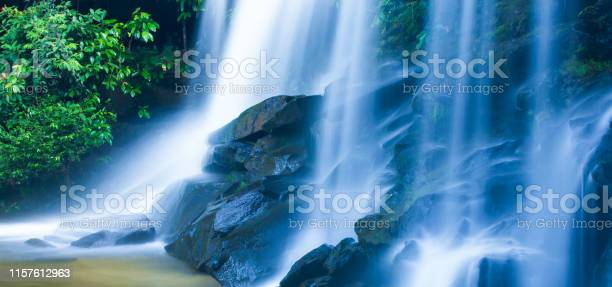 Photo of Picturesque tropical waterfall on summer morning.