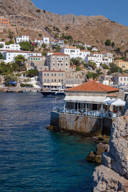 HYDRA, GREECE - 16 AUGUST 2019: Picturesque View at a restaurant in Port Town of Hydra Island in Greece stock photo