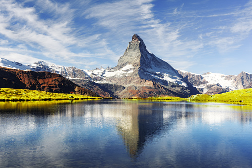 Picturesque view of Matterhorn Cervino peak and Stellisee lake in Swiss Alps. Day photo with blue sky. Zermatt resort location, Switzerland. Landscape photography