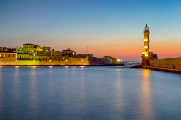 Picturesque View of Old Center of Chania  with Ancient Venetian Port and Ligthouse At Blue Hour in Crete, Greece.Horizontal Image