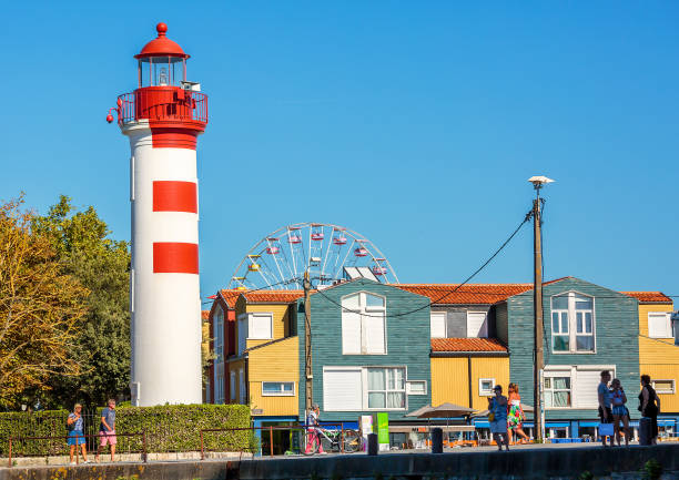 """A picturesque view of the """"Feu Anterieur"""" lighthouse. La Rochelle, France - August 22, 2016: A picturesque view of the red and white """"Feu Anterieur"""" lighthouse. feu stock pictures, royalty-free photos & images"""