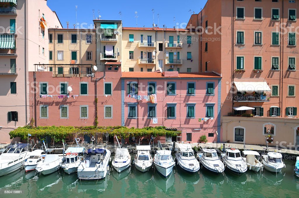Picturesque view on boats in city channel in Livorno, Italy stock photo