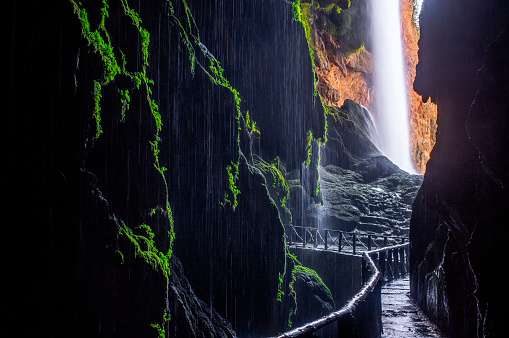 """Picturesque view on waterfall """"Cola de caballo"""" from the cave"""