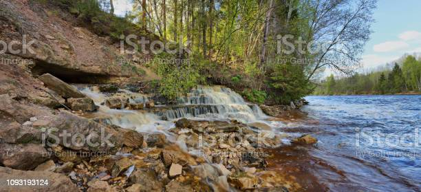 Photo of Picturesque waterfall on the river Bank