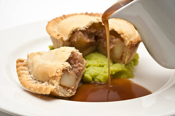 pie and mushy peas with gravy stock photo