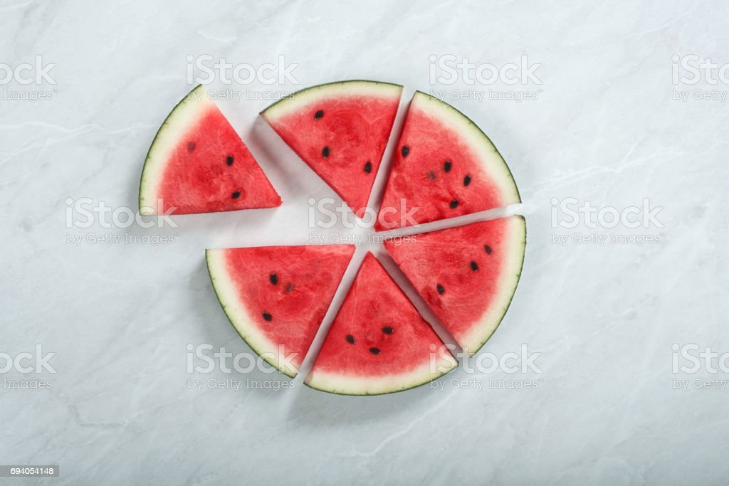 pie chart shaped fresh organic watermelon slices on the table stock photo