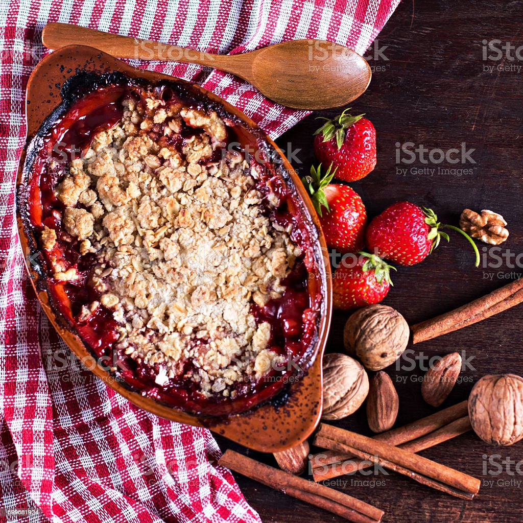 pie crumble with strawberries and rhubarb stock photo