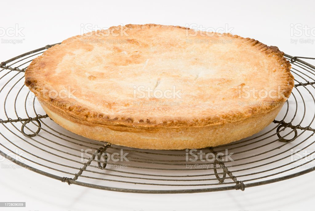 pie on cooling rack stock photo