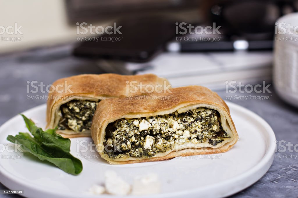Pie or strudel with spinach and feta cheese stock photo