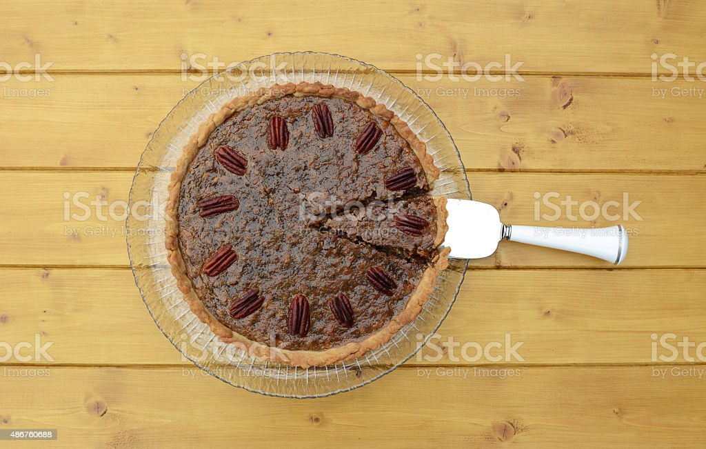 Pie server with cut slice in a traditional pecan pie stock photo