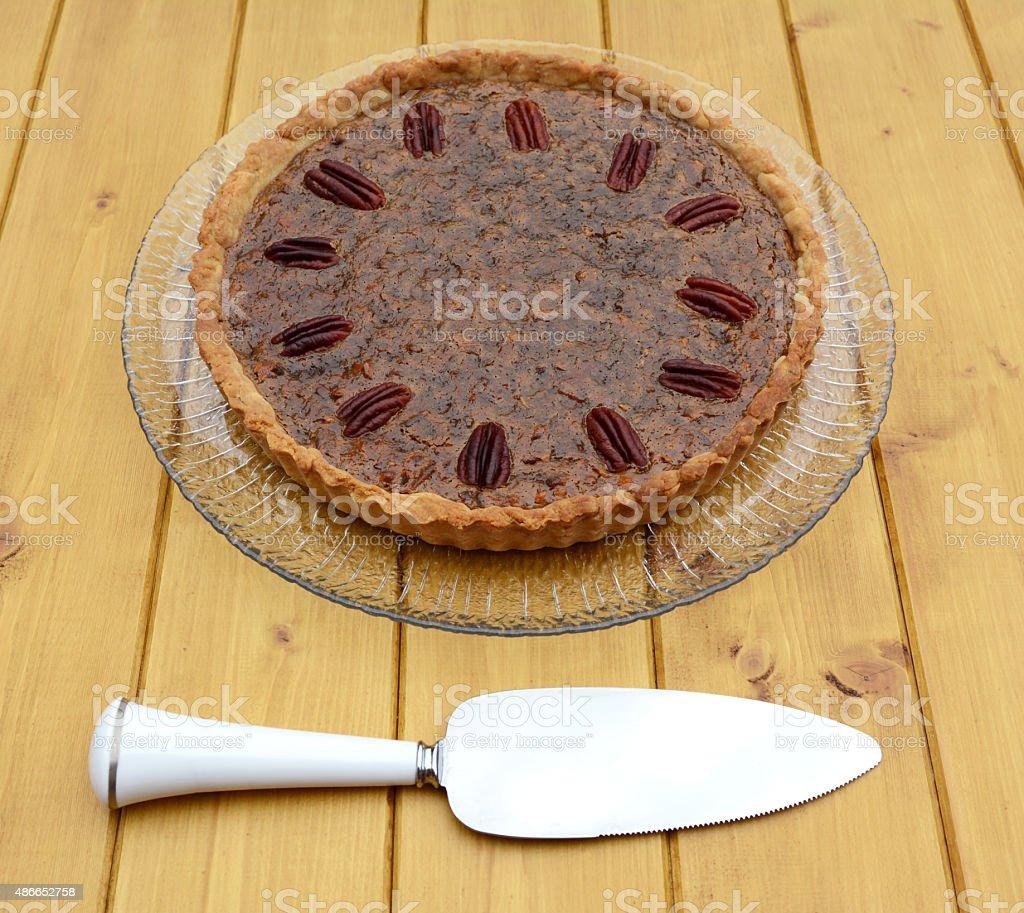 Pie server with pecan pie stock photo