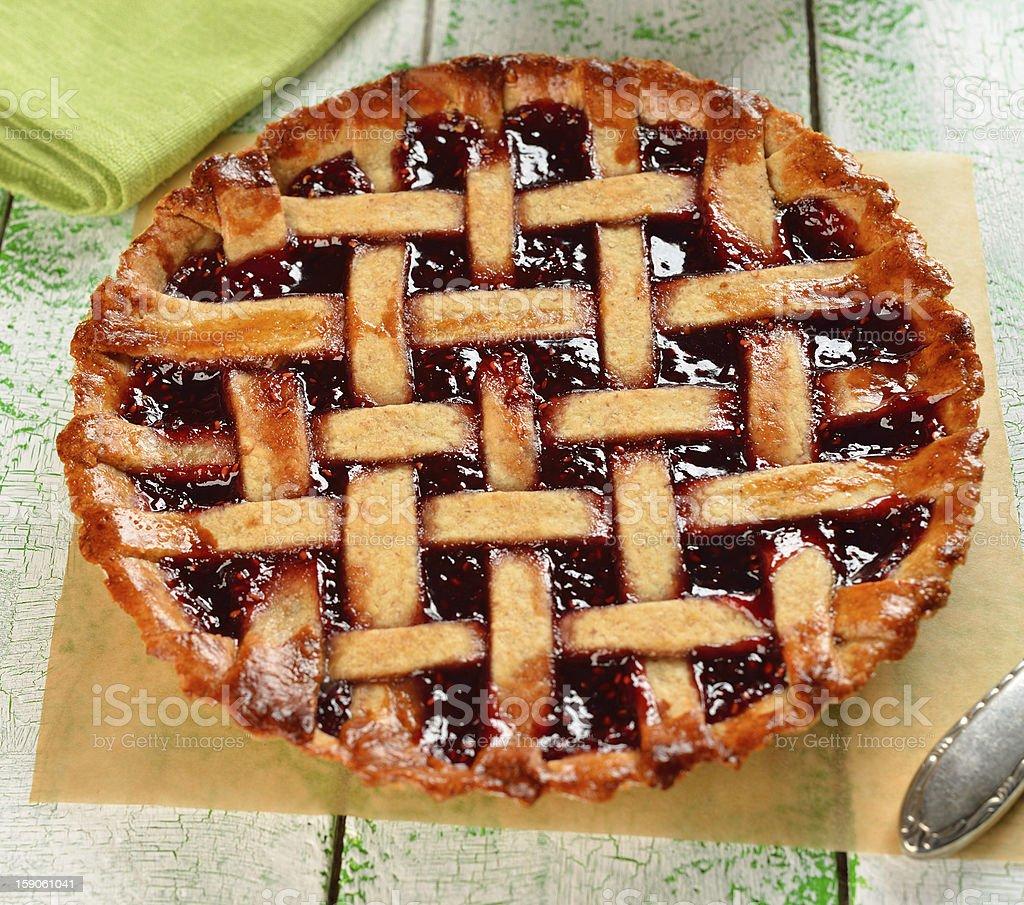 Pie with raspberry jam royalty-free stock photo