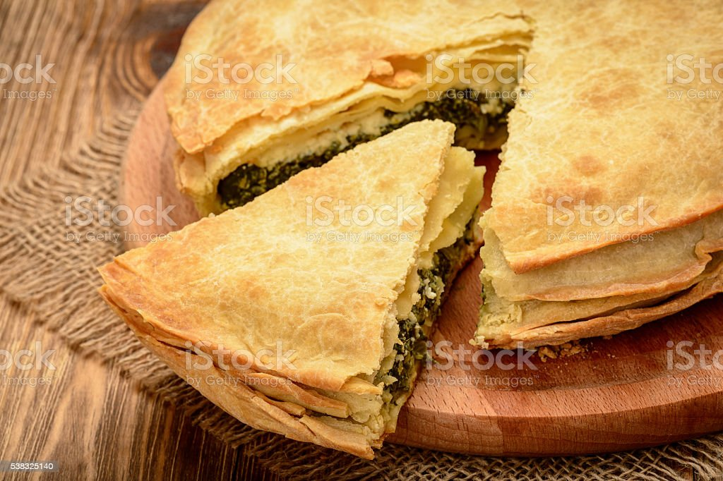 Pie with spinach and feta cheese - spanakopita, greek cuisine. stock photo