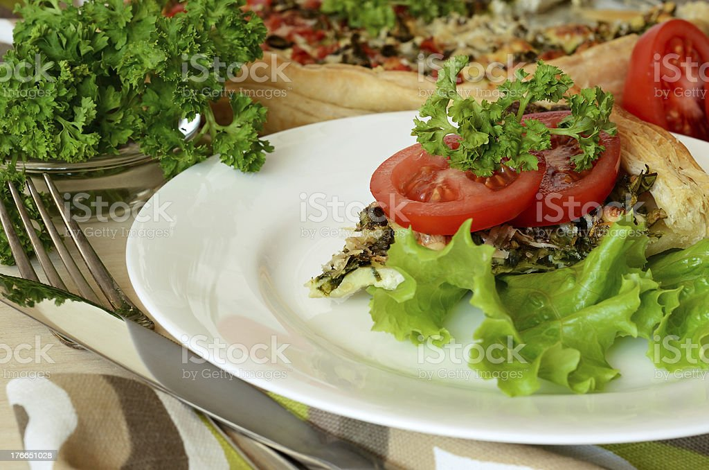 Pie with spinach, cheese and tomato royalty-free stock photo