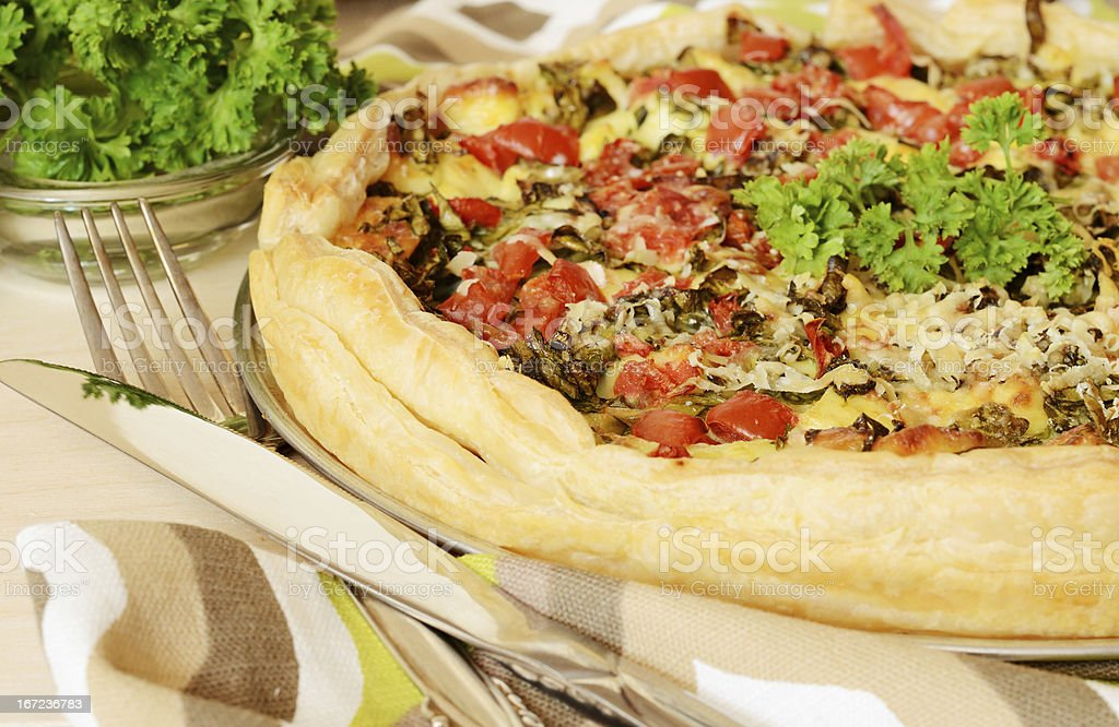 Pie with spinach, cheese and tomatoes royalty-free stock photo