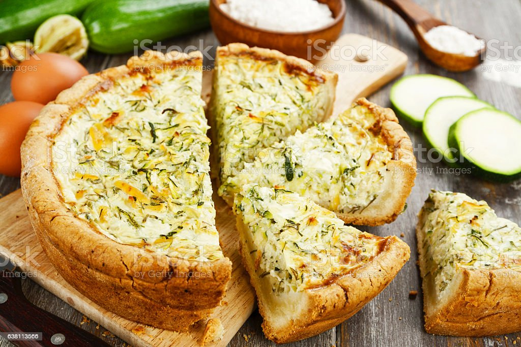 Pie with zucchini and herbs stock photo