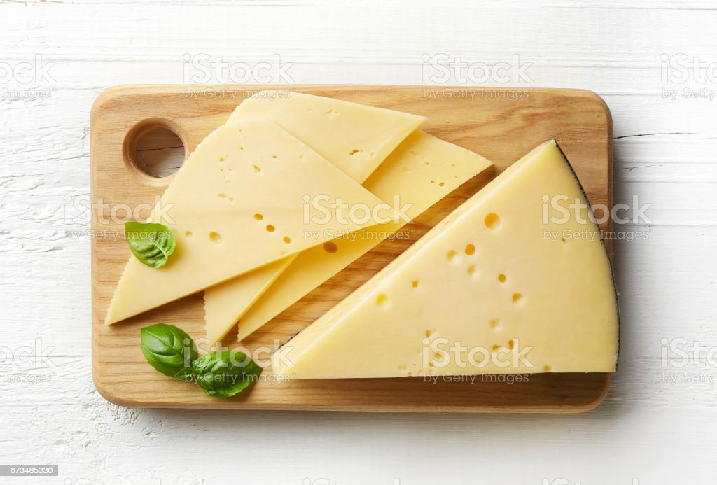 Piece and slices of cheese stock photo