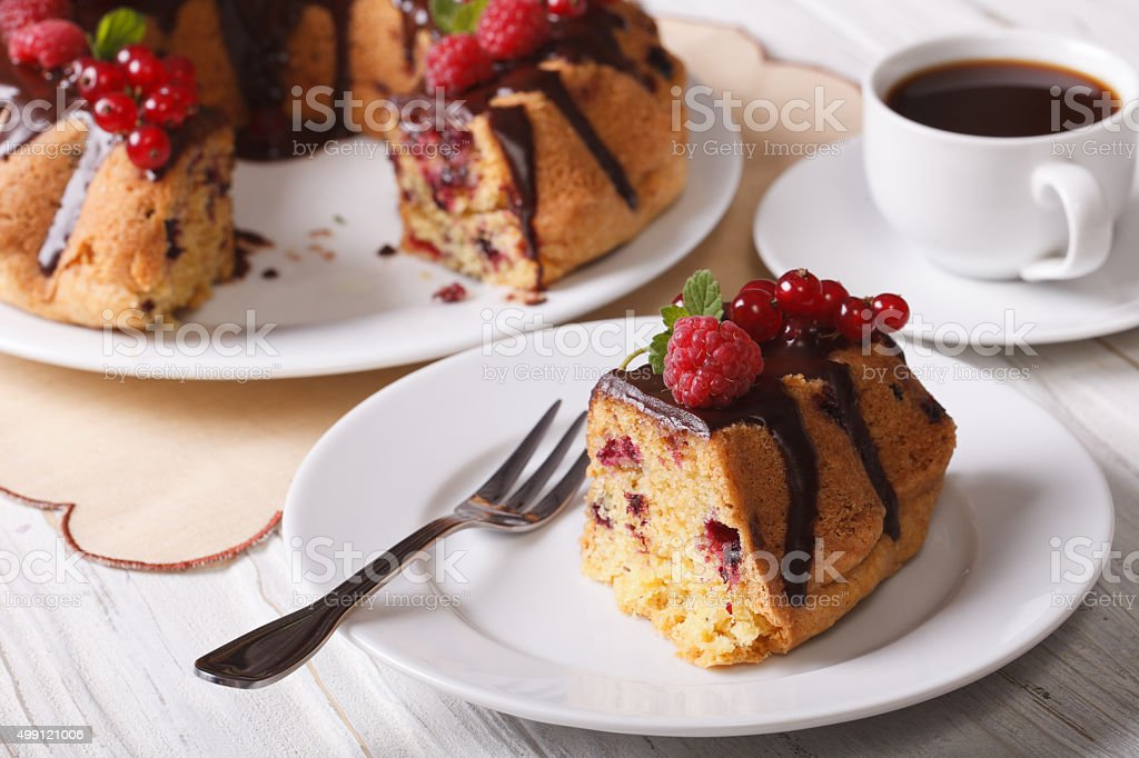 Piece chocolate cake with berries close-up and coffee. horizonta stock photo