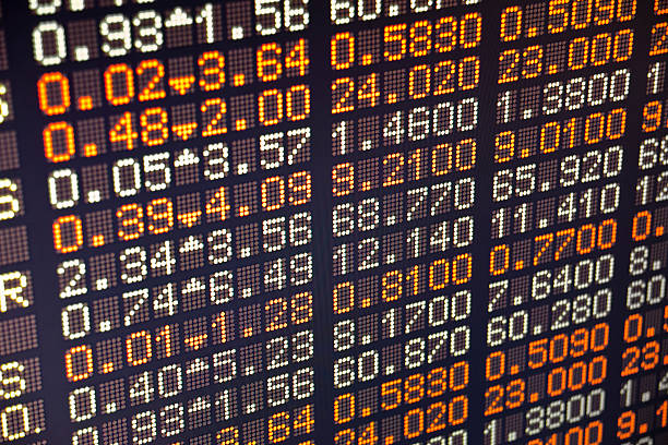 a piece of a board of a stock exchange - exchange rate stock pictures, royalty-free photos & images