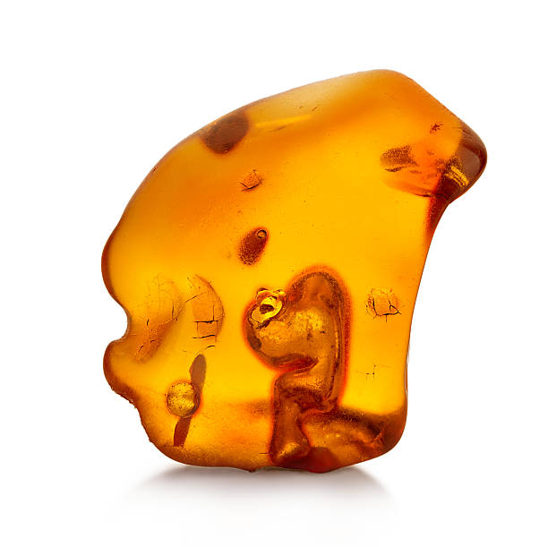 Piece of amber isolated on white background stock photo