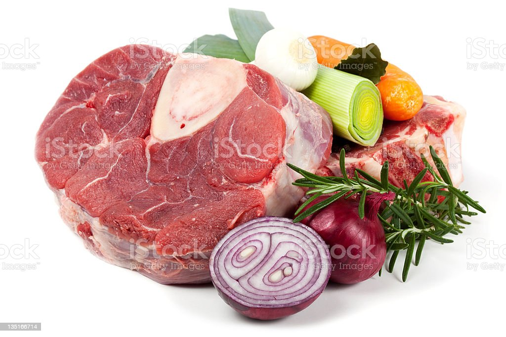 Piece of beef shank with vegetable stock photo