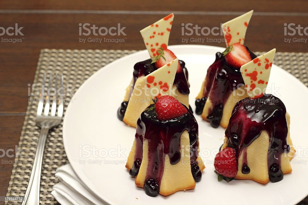piece of blueberry cheese cake on a tiny plate royalty-free stock photo