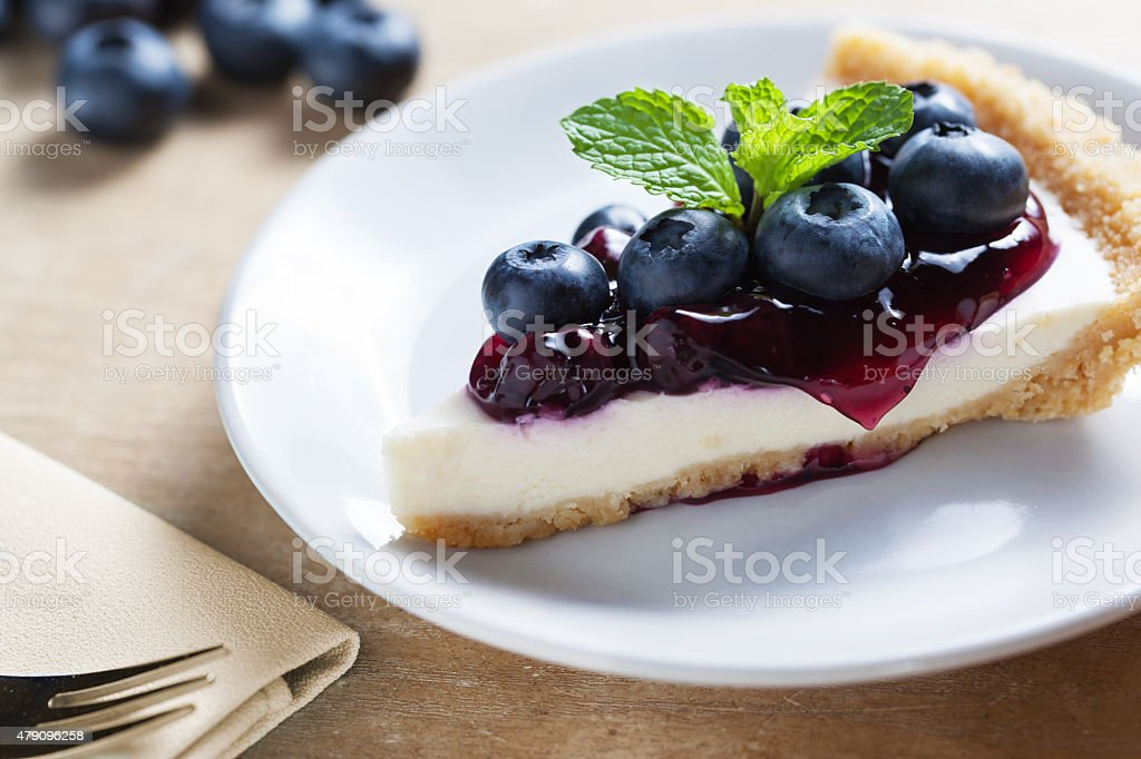 piece of blueberry cheesecake on plate stock photo