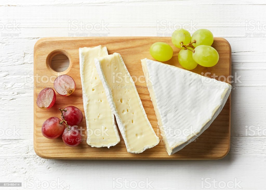 Piece of brie cheese - Photo