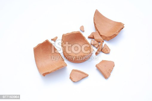 106415613istockphoto Piece of broken clay pots on white background. 977163964