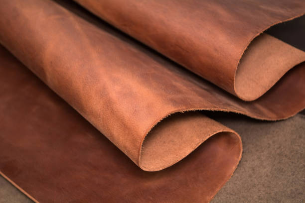 a piece of brown leather. texture of natural material - couro imagens e fotografias de stock